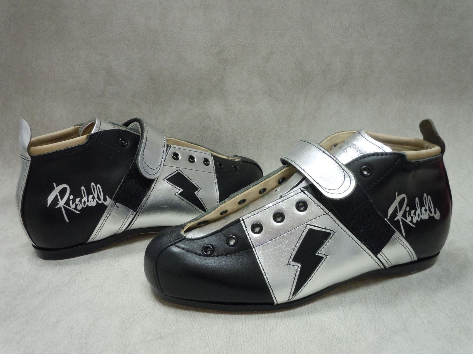 Riedell ColorLab Full Custom Boot - Model 1065 with Black and Metallic Silver Leather and custom lightning bolt graphic