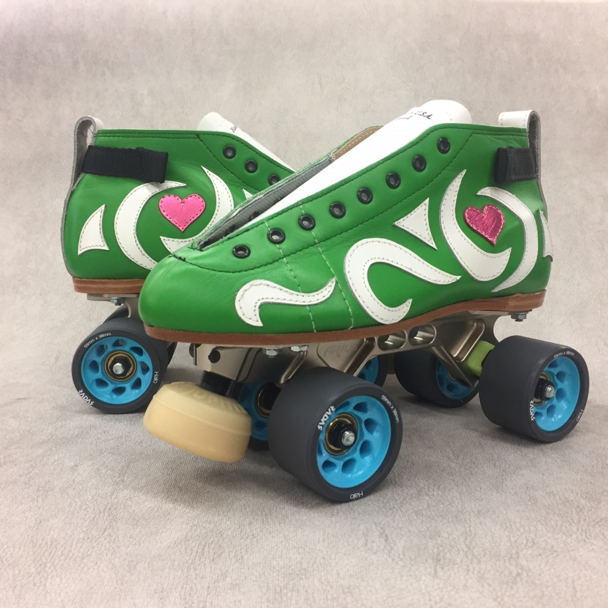 Hurricane Heather's Custom 395 Skates - Green Leather with custom graphics